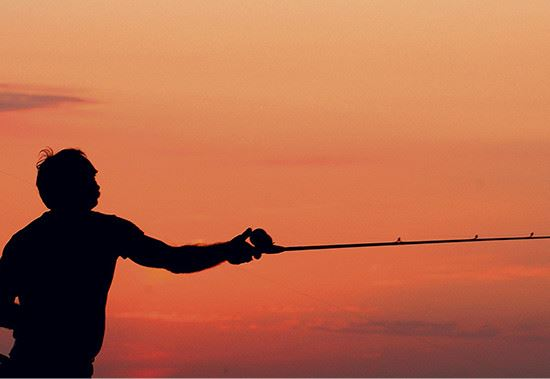 Sunset Silhouette of Fisherman